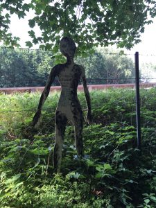 Wooden figure to remember Bergen-Belsen victims. Photographer Marion Kummerow